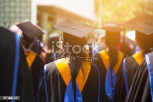 Group of Graduates during commencement. Concept education congratulation in University. Graduation Ceremony in University during commencement. close up hat.