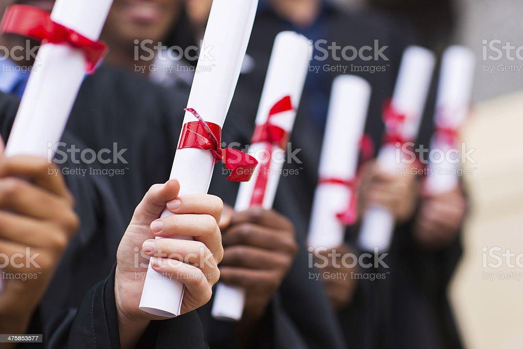 group of graduates holding diploma royalty-free stock photo