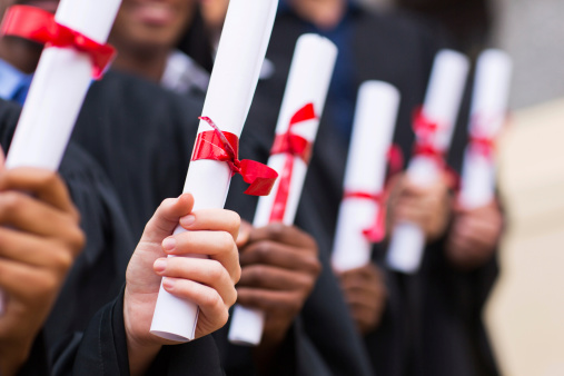 Group Of Graduates Holding Diploma Stock Photo - Download Image Now