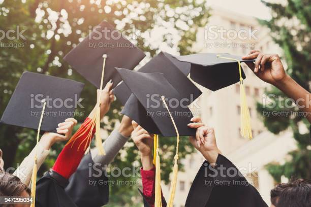 Group of graduates throwing graduation caps in the air picture id947295034?b=1&k=6&m=947295034&s=612x612&h=o8ujascarqk8shkbfg4j3bc8gqwfr9tto4wxmgxhe6k=