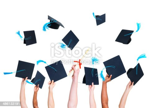 istock Group of Graduating Student's Hands Holding and Throwing Graduatation Hats 486133191