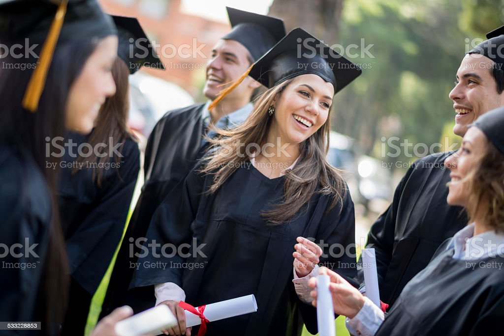 Group of graduation students stock photo
