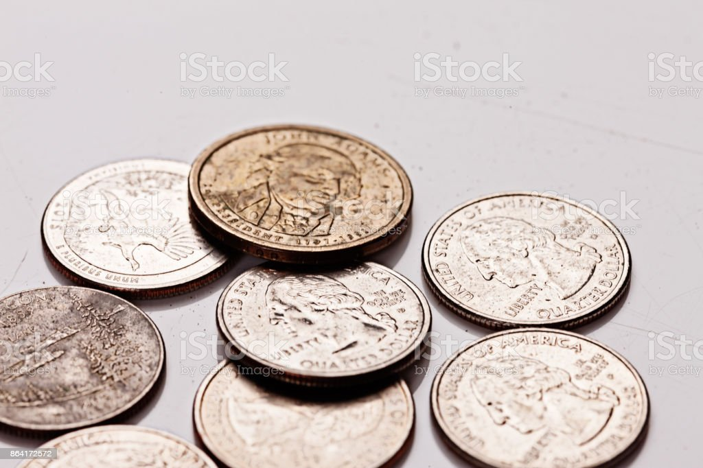 Group of grubby old american coins on gray royalty-free stock photo