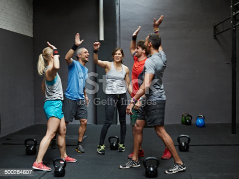 istock Group of gymters celebrating workout 500284607