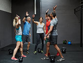 Group of gymters celebrating workout after class