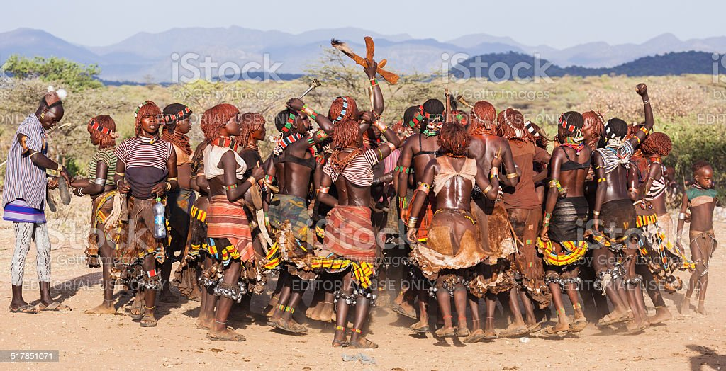 Group of Hamar women dance during bull jumping ceremony. stock photo