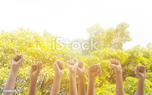 istock Group of hand raise up many people community service, International volunteer day and human rights day concept 1059649170