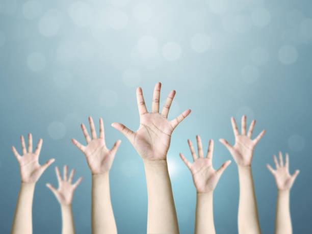 Group of hand raise up many people, International volunteer day and community service concept - foto stock