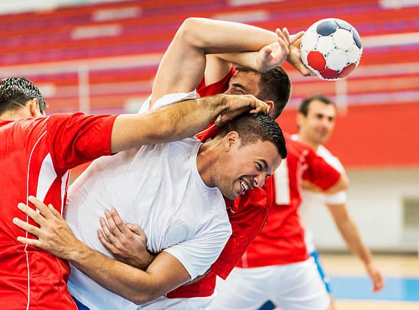 group of handball players in action. - handboll bildbanksfoton och bilder