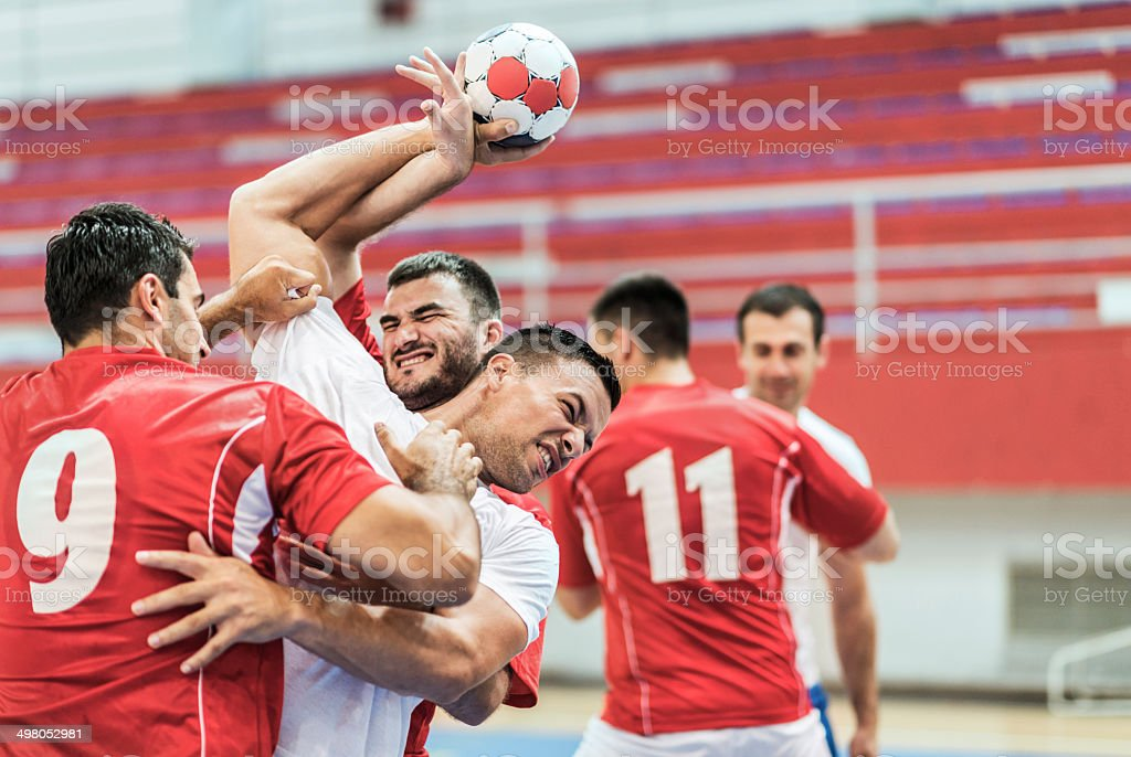 Group of handball players in action. stock photo