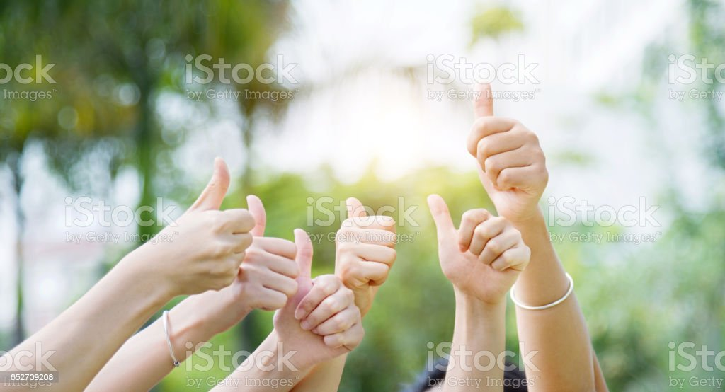 Group of hands giving thumbs up stock photo