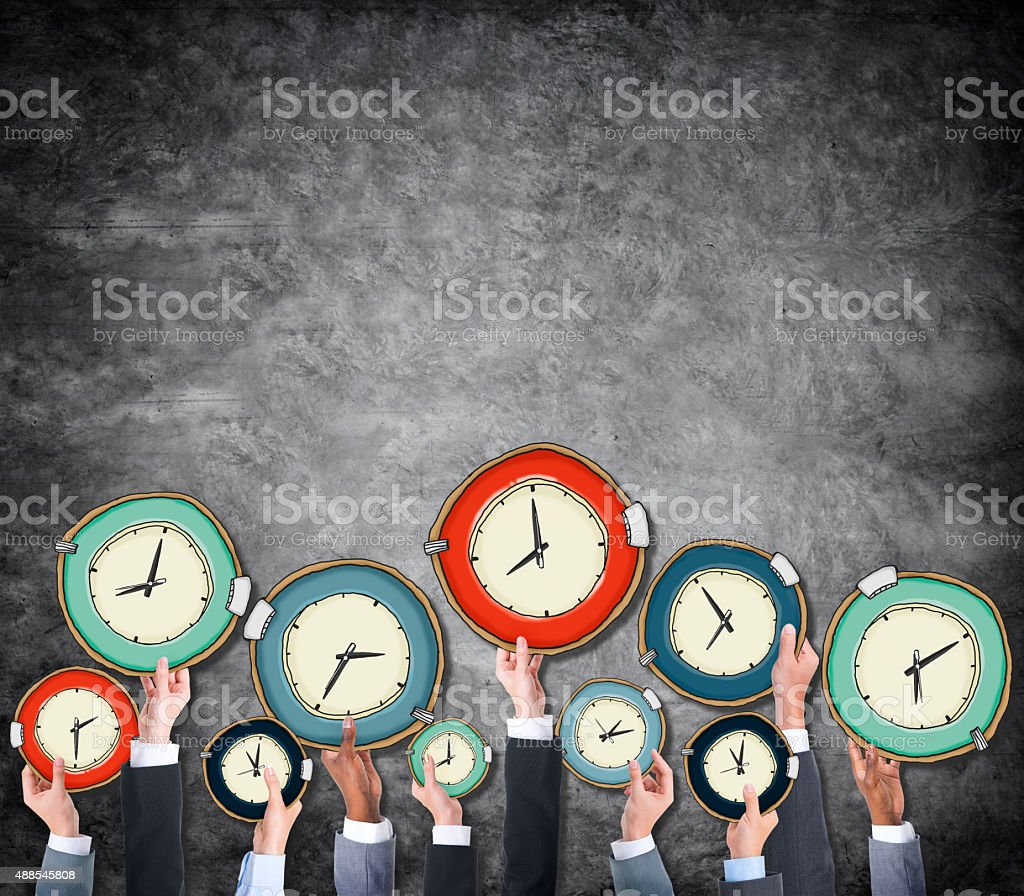 Group of Hands Holding Clock stock photo