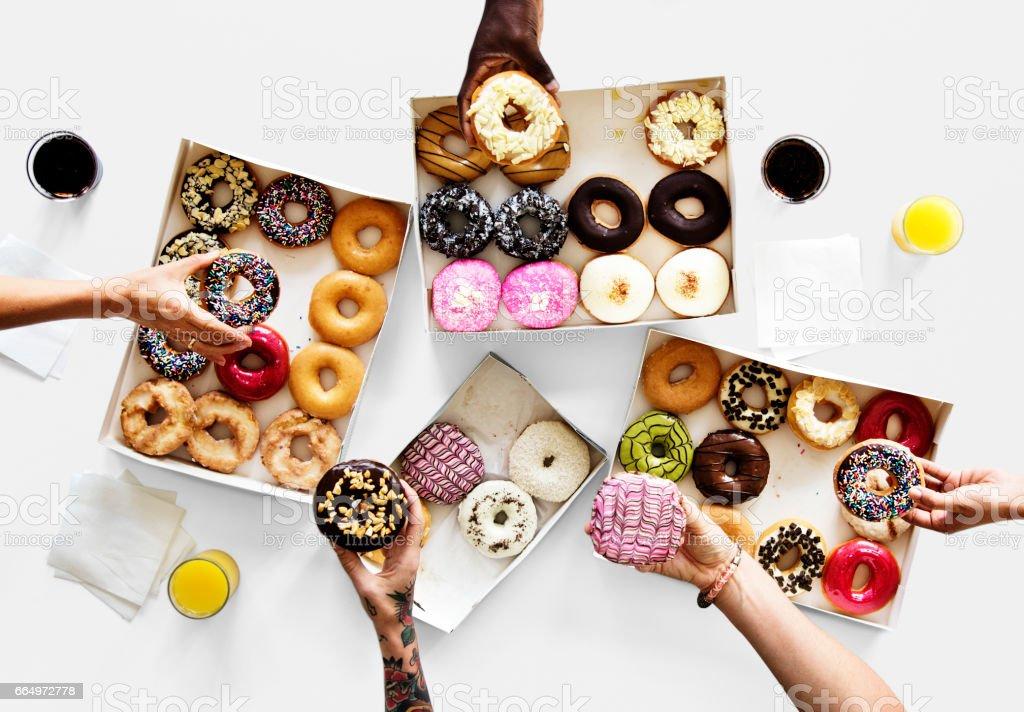 Group of hands holding sweeten donut dessert stock photo