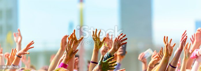 istock Group of hands in the air 647882166
