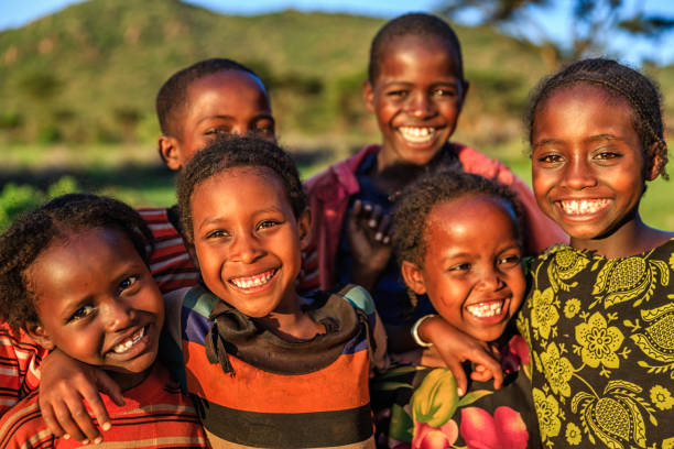 group of happy african children, east africa - african culture stock photos and pictures