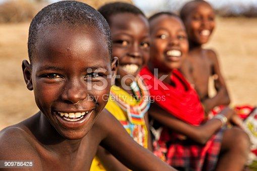 istock Group of happy African children from Samburu tribe, Kenya, Africa 909786428