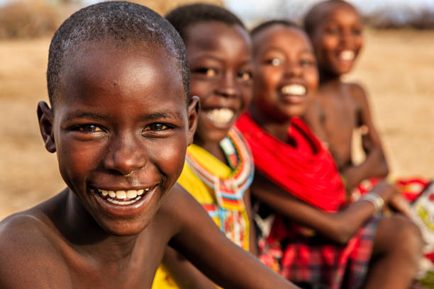 Group of happy African children from Samburu tribe, Kenya, Africa Group of happy African children from Samburu tribe, Kenya, Africa. Samburu tribe is north-central Kenya, and they are related to  the Maasai. village stock pictures, royalty-free photos & images