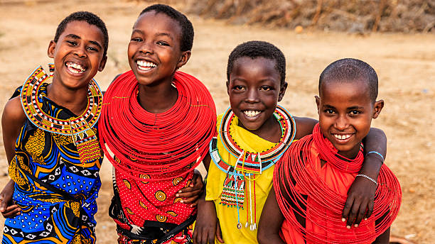 group of happy african girls from samburu tribe, kenya, africa - kenyan culture stock photos and pictures