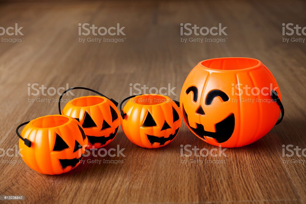 Group of happy and smiling jack-o-Lantern pumpkin buckets stock photo