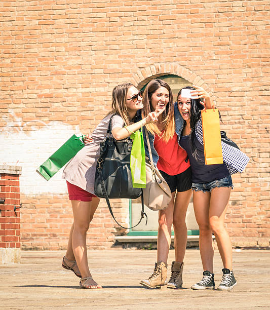 group of happy best friends with shopping bags taking selfie - beautiful college girl pics stock photos and pictures