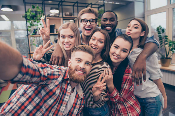 group of happy cheerful best friends making selfie - team event stock photos and pictures