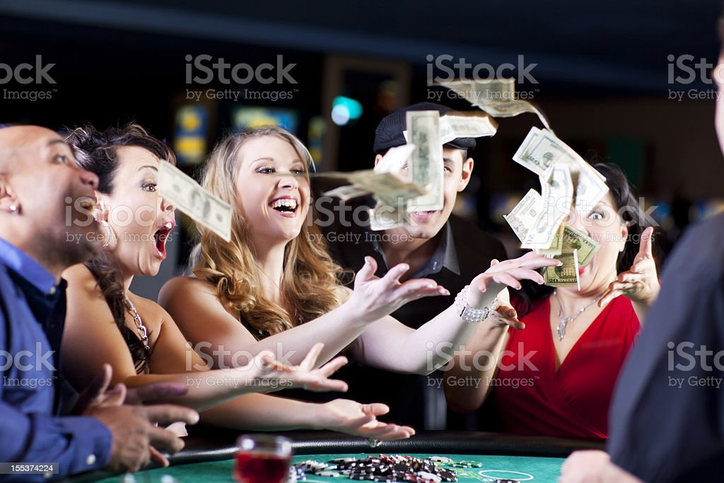 Group of happy diverse people at the blackjack table royalty-free stock photo