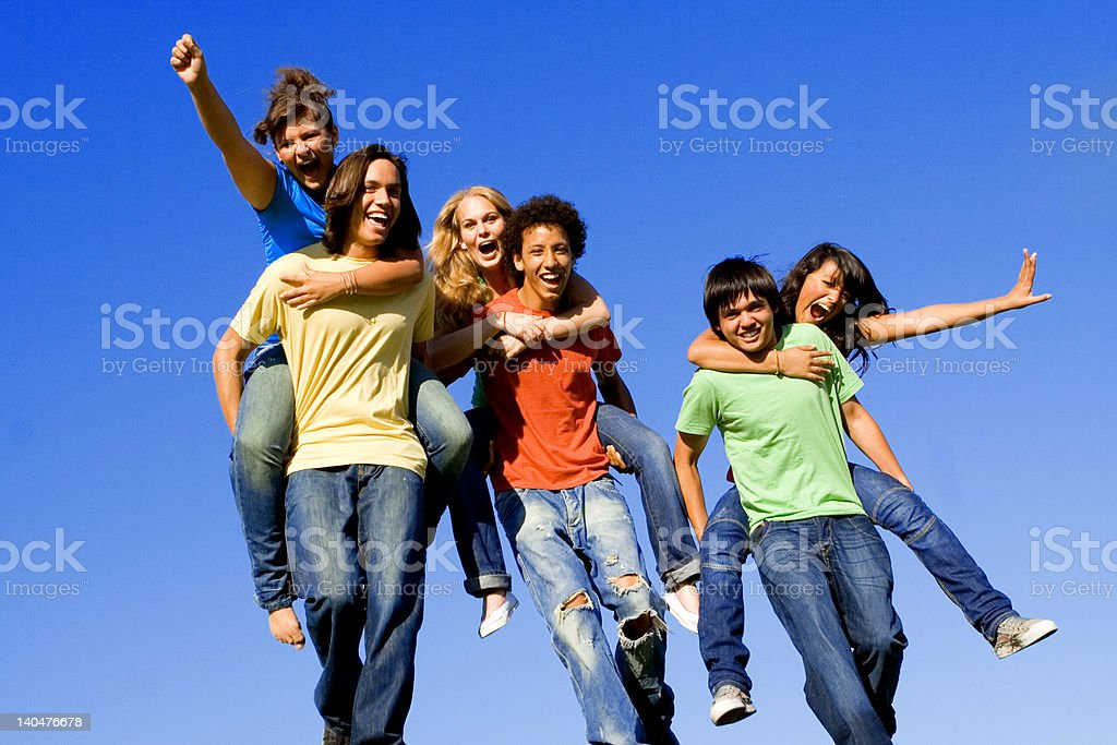 group of happy diverse teens or youth playing piggyback race stock photo