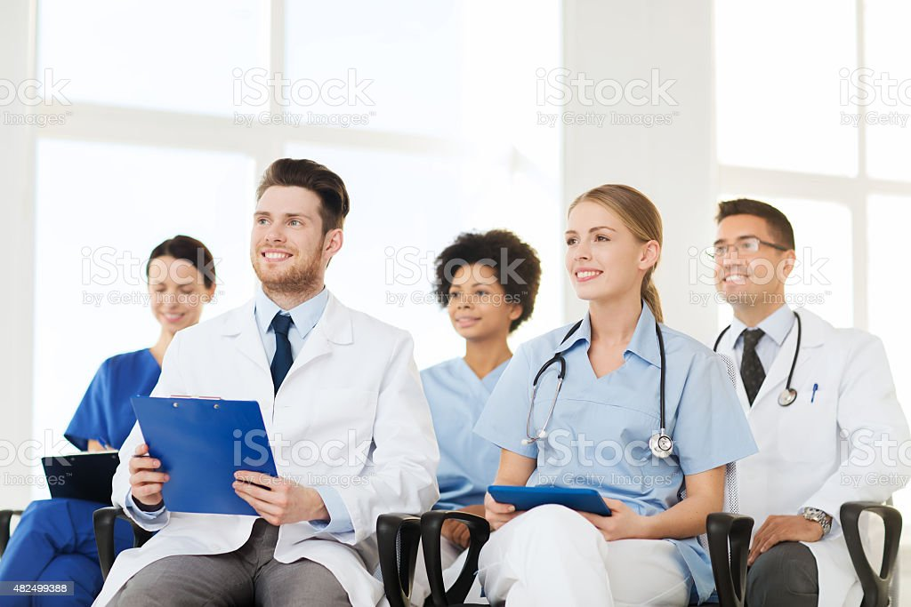 group of happy doctors on seminar at hospital stock photo