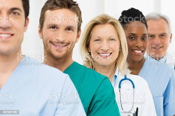 Group Of Happy Doctors Stock Photo - Download Image Now