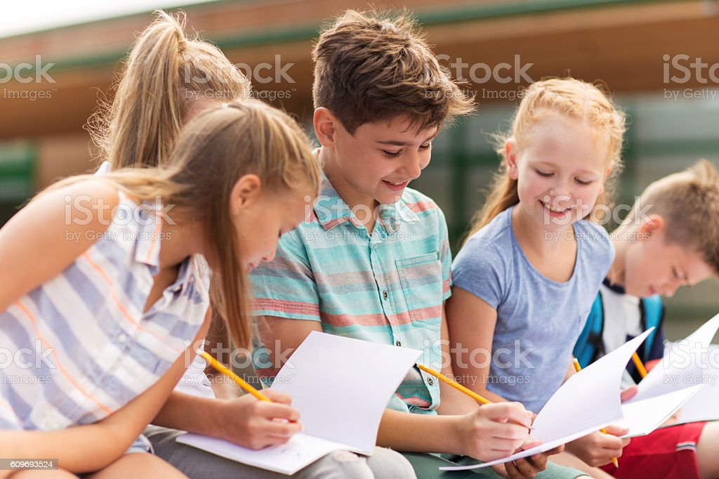 group of happy elementary school students outdoors royalty-free stock photo