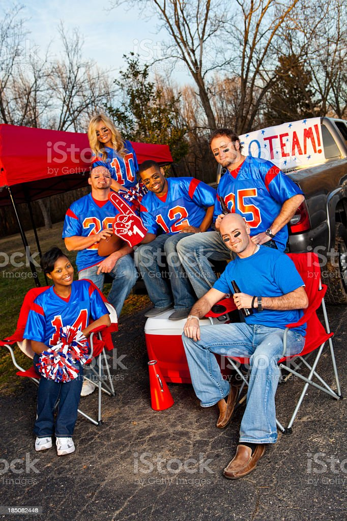 Group of happy football fans in blue and red shirts stock photo