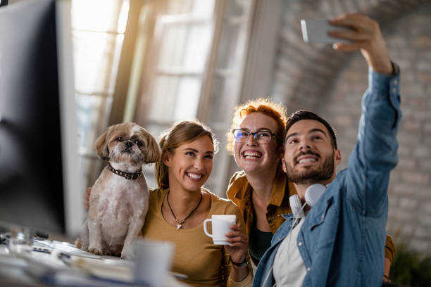 Group of happy freelancers with a dog taking selfie in the office picture id1185448000?b=1&k=6&m=1185448000&s=612x612&w=0&h=3fzdhvsbqm4srwiooy61kyzuv6oura4wroxljjb e38=