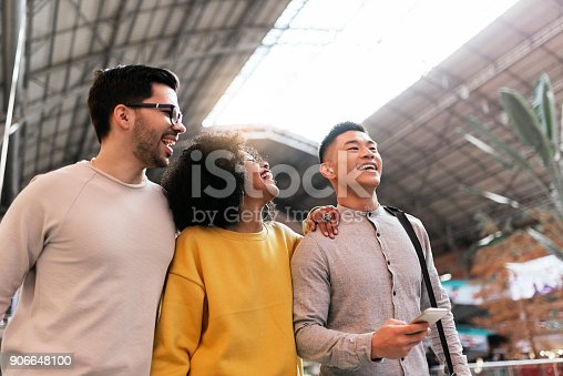 istock Group of happy friends chatting in the train station. 906648100