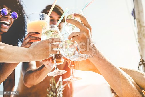 istock Group of happy friends cheering with tropical cocktails at boat party - Young people having fun in caribbean sea tour - Youth and summer vacation concept - Focus on bottom hands glass 937868622