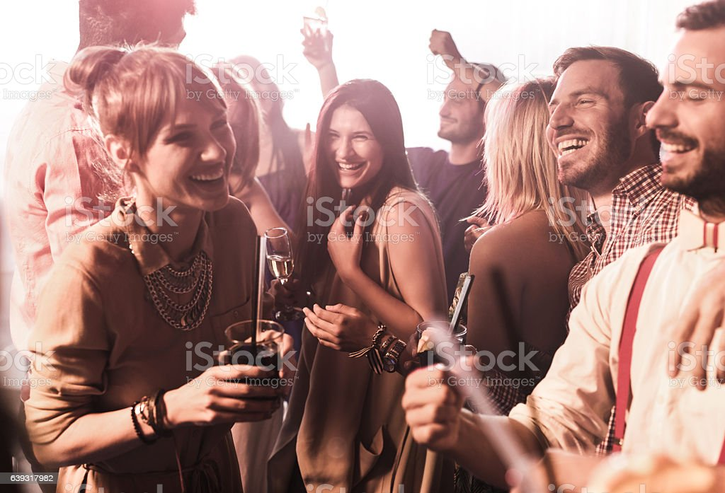 Group of happy friends clubbing and having fun. stock photo