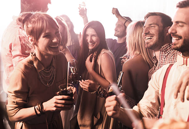 group of happy friends clubbing and having fun. - happy hour stock photos and pictures