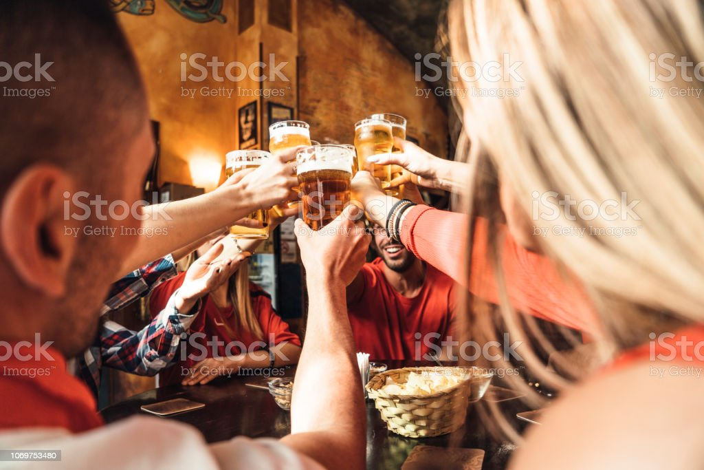 Group of happy friends drinking beer at the brewery stock photo