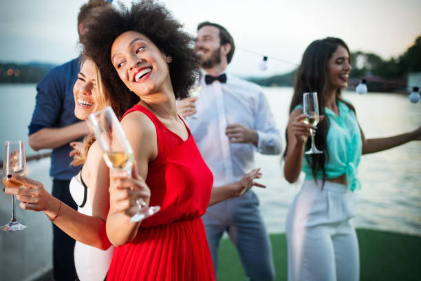 group of happy friends drinking champagne and celebrating new year - public celebratory event stock photos and pictures