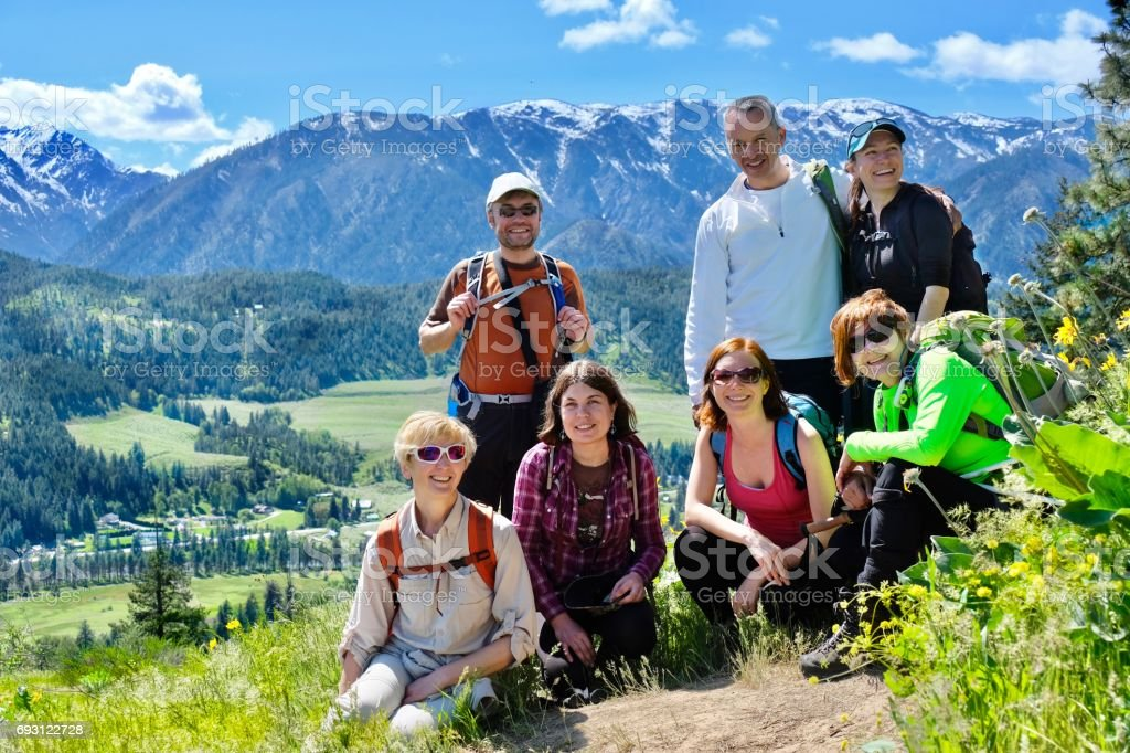Group of happy friends hiking in Cascade Mountains near Leavenworth. stock photo