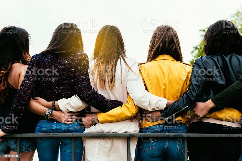 Group of happy friends hugging. stock photo