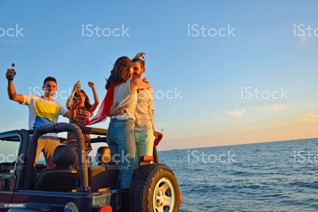 Group of happy friends making party in car - Young people having fun...
