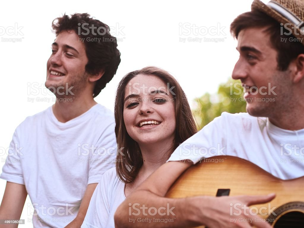 Group of happy friends playing music stock photo