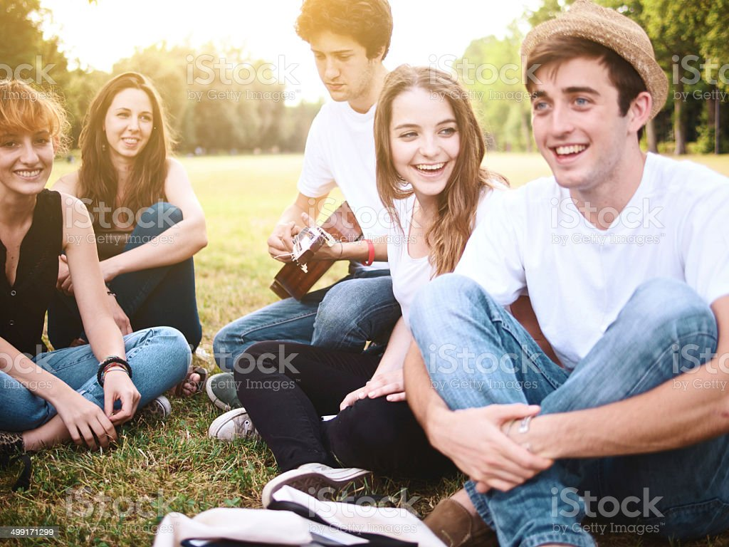 Group of happy friends playing music royalty-free stock photo