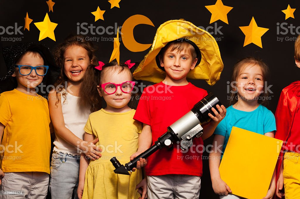 Group of happy friends playing sky watchers stock photo