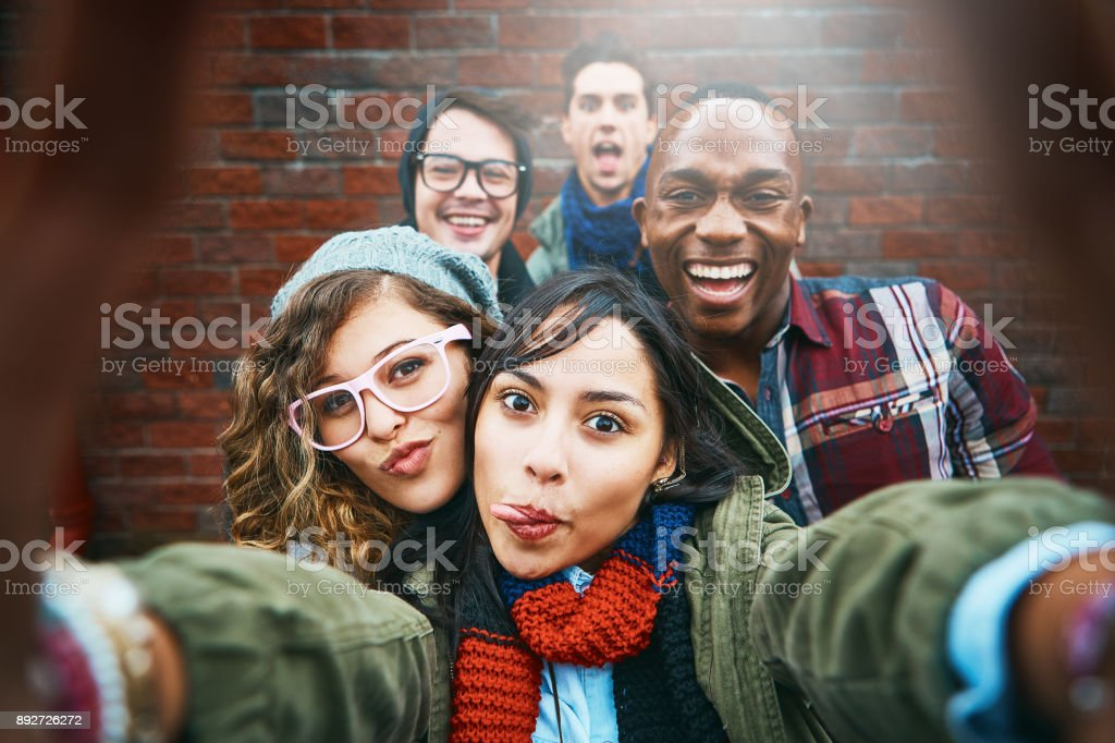 Group of happy friends take selfie outdoors stock photo