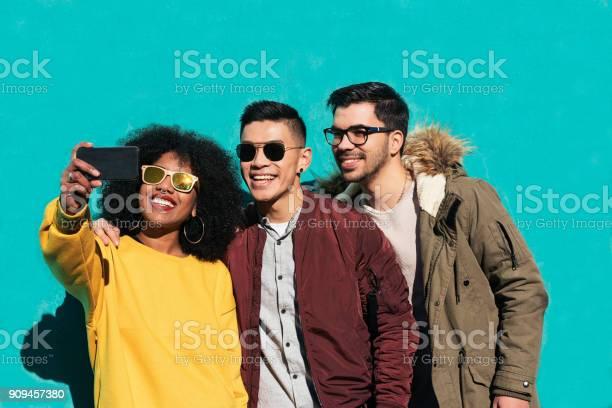 Group of happy friends taking a selfie in the street picture id909457380?b=1&k=6&m=909457380&s=612x612&h=osu7npm3qmrpfovae7j0szzonwq38nen1bdn27l7l3a=