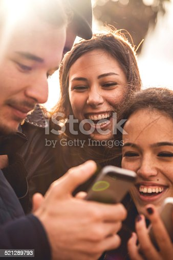 istock Group of happy friends taking a selfie 521289793