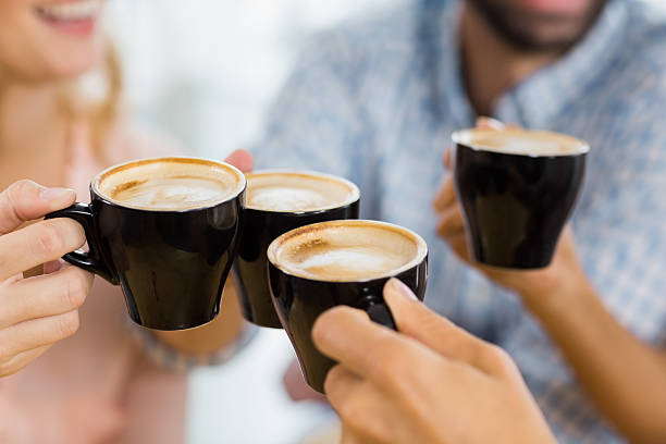 Group of happy friends toasting cup of coffee - Photo