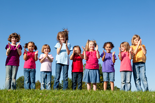 Group Of Happy Girls Cheering And Clapping Stock Photo - Download Image Now