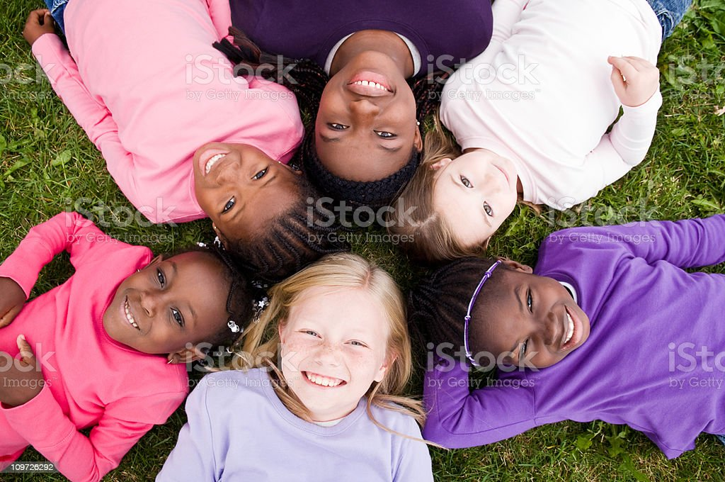 Group of Happy Girls Lying in a Circle stock photo